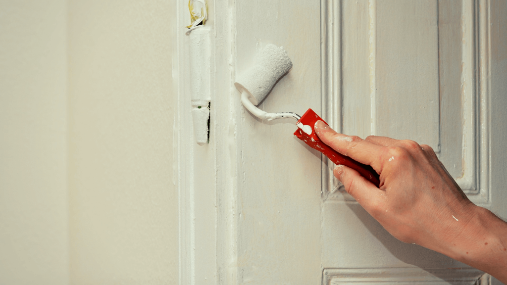 Person painting a HMO Fire Door